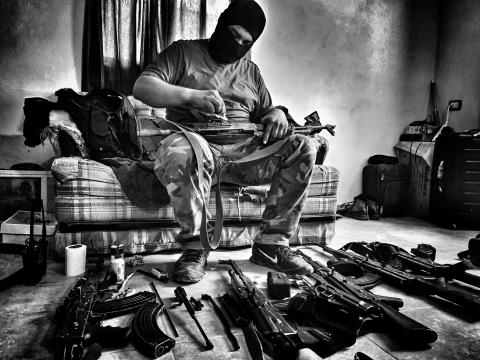 Sinaloa man cleans guns. (Credit: Nick Quested)