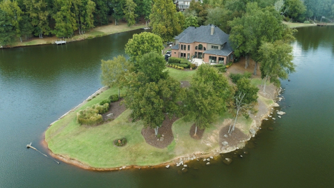 Located on the point of a local lake, the McSweeney property offers stunning views and the tranquility that comes with being surrounded by water. (Photo: Business Wire)
