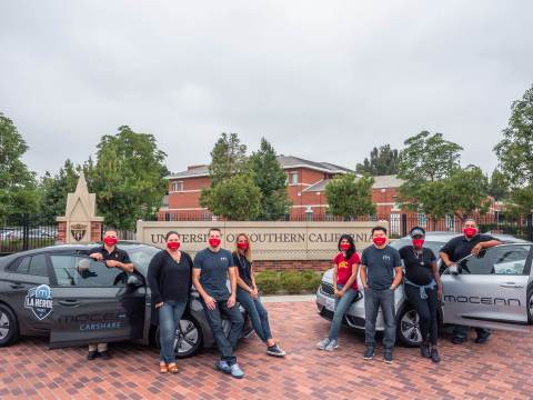 Representatives from MoceanLab and the USC Keck School of Medicine pose with two low-emission hybrid vehicles provided to USC's Street Medicine Team to help serve L.A.'s unsheltered homeless population. (Photo: Business Wire)