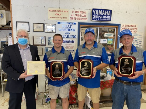 Dustin Bearden is the first to complete the Yamaha Marine Apprentice Program. (Left to Right) Florida Department of Education Apprenticeship Director, Ted Norman, Sunshine Marine Apprentice, Dustin Bearden, Sunshine Marine Co-Owner, Marvin Lawler, Sunshine Marine Co-Owner and Mentor, Pete Magnuson.