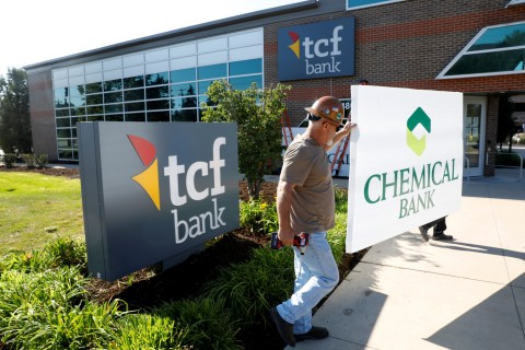 Universal Sign workers exchange Chemical Bank sign for TCF sign at banking center location in Southfield, Michigan on Friday, August 7th. (Photo: TCF Bank)