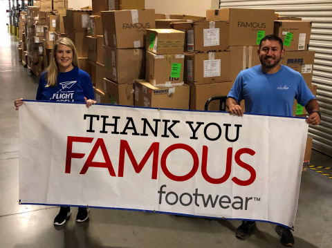 Ticket to Dream's Program Director Mauri Knowles and Program Officer Juan Garcia unload 12,000 pairs of shoes at Pride Industries in Roseville, CA. The shoes were donated by Famous Footwear and they will be shipped across the country to non-profit, foster care agencies that partner with Ticket to Dream. (Photo: Business Wire)