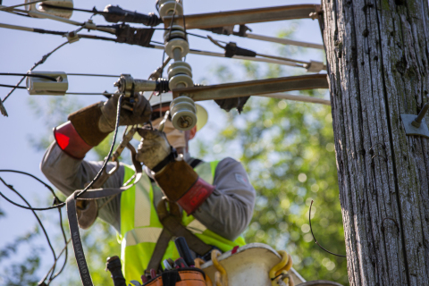 ComEd worker repairs damage from Monday's derecho. (Photo: Business Wire)