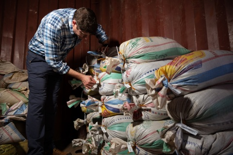 Adam Schafer, director of Supply Chain Sustainability at Intel, inspects bags of ore that have been sealed and tagged to confirm its provenance. A team from Intel's Responsible Minerals Program, as well as representatives of other tech firms, visited mineral-rich Rwanda in November 2019 as part of an industry effort to ensure a legal and ethical supply chain. Tin, tantalum, tungsten and gold mined in the Central African country are key components of silicon chips that run today's smartphones, laptops, servers and other high-tech gear. (Credit: Walden Kirsch/Intel Corporation)