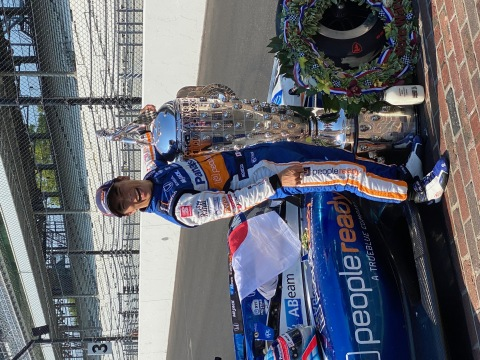 Takuma Sato, celebrating his second Indy 500 win next to his PeopleReady branded car. PeopleReady is the primary sponsorship partner with Sato and the Rahal Letterman Lanigan Racing team. (Photo: Business Wire)