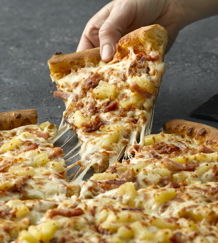 Papa John's Super Hawaiian Pizza, now featuring juicy DOLE pineapple tidbits (Graphic: Business Wire)