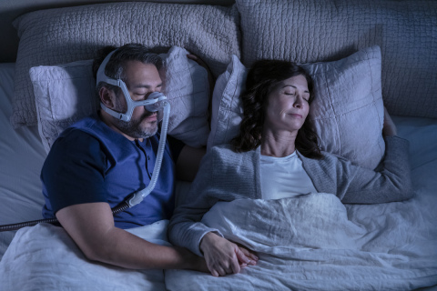 ResMed AirTouch N20 nasal CPAP mask, couple sleeping, overhead view (Photo: Business Wire)