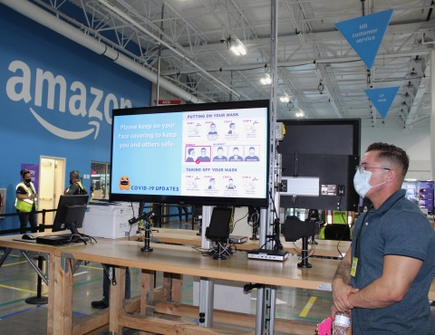 Safety messaging is displayed in the fulfillment center to remind associates how to properly wear masks. (Photo: Business Wire)