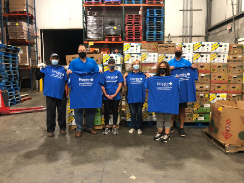 Jason O'Malley, regional vice president of sales and Albany market leader for Empire BlueCross, joins colleagues during Volunteer Day activity to sort and package food boxes for distribution at the Regional Food Bank of Northeastern New York (Photo: Business Wire)