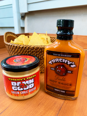 For the first time ever, fans of Torchy's Tacos, the Austin-based craft casual taco brand, will be able to purchase its signature Green Chile Queso and Diablo Sauce at participating Whole Foods locations in Texas, Arkansas, Oklahoma and Louisiana. (Photo: Business Wire)
