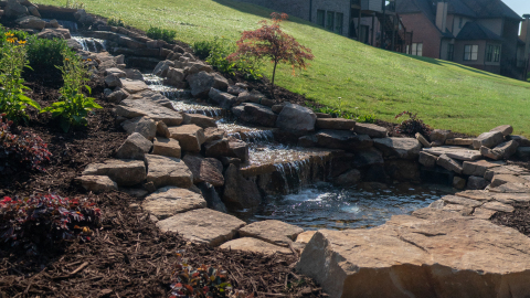 The water feature uses a combination of boulders and flagstone to create visual texture and the soothing sounds of a gently flowing stream. (Photo: Business Wire)