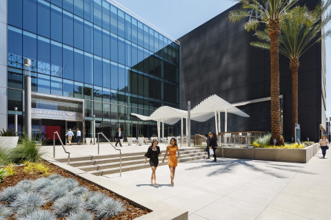 EMMES' award-winning downtown office building, 701B, features an 'urban oasis' plaza design that welcomes tenants and guests. (Photo: Business Wire)