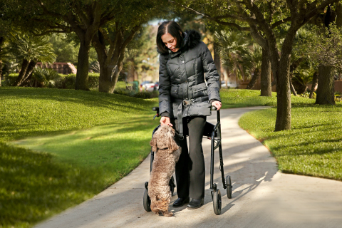 Josie Ingber, who has multiple sclerosis, maintains her independence and mobility with the LifeGlider, a walking aid that secures the center of gravity to eliminate users' fear of falling. (Photo: Business Wire)