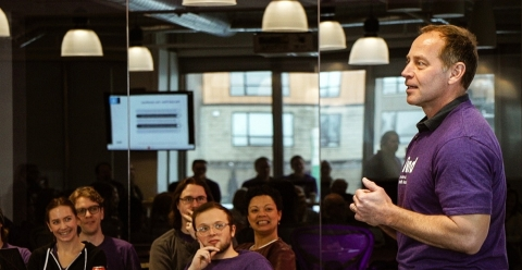 Bind CEO Tony Miller speaks to employees, late last year, about the value proposition and growth of Bind. The company is now expanding into the fully-insured market. (Image: Bind)