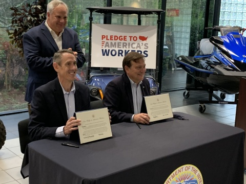 During a visit with U.S. Secretary of the Interior David Bernhardt (standing) at Yamaha's facility in Newnan, Ga., Mike Chrzanowski, President of Yamaha Motor Manufacturing Corporation (seated left) and Ben Speciale, President of Yamaha U.S. Marine Business Unit (seated right) signed the Pledge to America's Workers, reinforcing Yamaha's commitment to workforce development. (Photo: Business Wire)