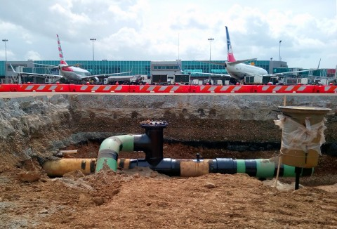 Teams install hydrant system piping and pits at the international terminal expansions at the El Dorado Airport in Bogota, Colombia. (Photo: Business Wire)