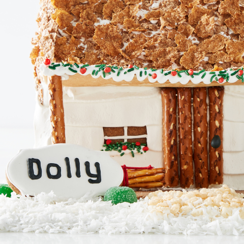 Dolly Parton Launches New Collaboration with Williams Sonoma Featuring a Gingerbread Log Cabin Replica of Her Childhood Home (Photo: Williams Sonoma)