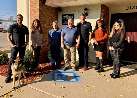 The ELP logo stencil was sprayed at their facility in Aurora along with a photo taken of available employees. (Photo: Business Wire)