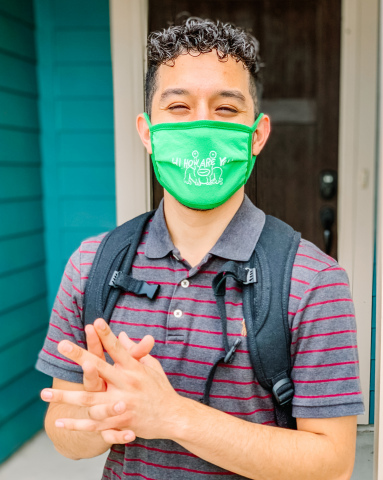 Texas State University student wearing Hi, How Are You Project mask. (Photo: Business Wire)
