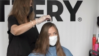 Hair Cuttery Stylist & Guest Emily Taylor at Aventura, Miami Curbside Cuts (Photo: Business Wire)