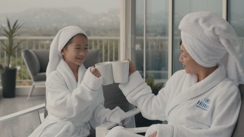 Still photo from Hilton's To New Memories campaign. (Photo: Business Wire)