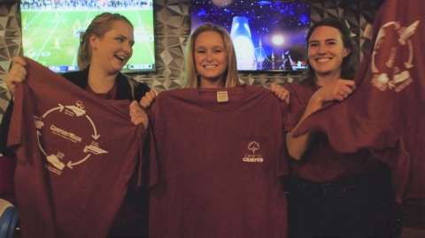 "North Carolina State University students Sydney Parker, Katy Powers and Mamie Trigg present their self-designed T-shirts to campus students during a wrap party for ""Crop to Campus,"" a seven-part, minidocumentary that follows the students on a step-by-step exploration of making a sustainable T-shirt. (Photo: Business Wire)"