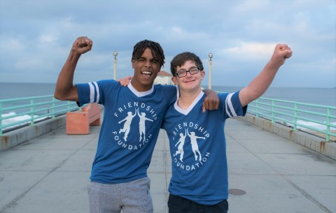 Friendship Foundation buddies Marcus and Owen celebrate at last year's Skechers Pier to Pier Friendship Walk. The annual event will be held virtually on Sunday, October 25th, featuring celebrities, sponsors and the community to support children with special needs and education. (Photo: Business Wire)
