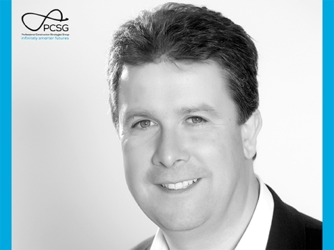 Dr. Mark Bew MBE, Chairman of PCSG (Photo: Business Wire)