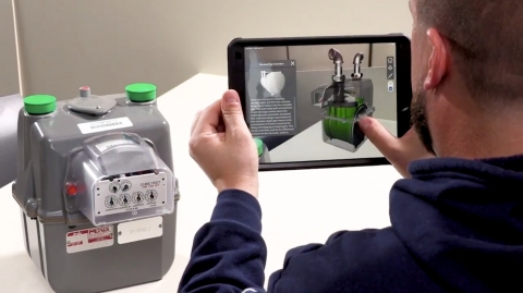 Utility technician uses a SuperApp from Index AR Solutions to visualize how a natural gas meter operates. (Photo: Business Wire)