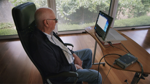 Graham Felstead, the first patient enrolled in the first Stentrode clinical study and the first person to have any BCI implanted via the blood vessels. He utilized the Stentrode to control the Microsoft Windows 10 operating system, in combination with an eye-tracker for cursor navigation, without the need for a mouse or keyboard. (Photo: Synchron, Inc.)