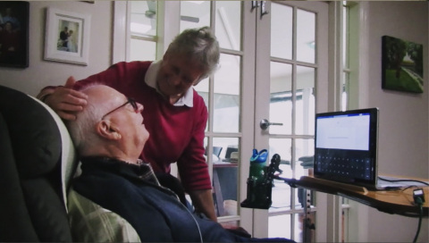 Graham Felstead, a 75-year-old man who has ALS and lives at home with his wife, was the first patient enrolled in the first Stentrode clinical study.  He was able to achieve his goals of remotely contacting his spouse, increasing his autonomy and reducing her burden of care. (Photo: Synchron, Inc.)