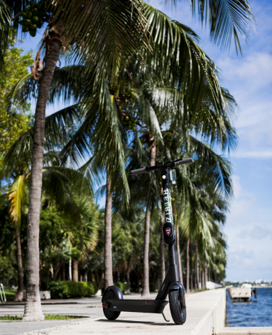 Helbiz re-deploys fleet of new e-scooters with swappable batteries and attached hand sanitizer within Downtown Miami and Brickell. (Photo: Business Wire)