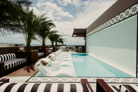 Rooftop pool and bar at Marquee Playa Hotel in Playa Del Carmen, Mexico. (Photo: Business Wire)