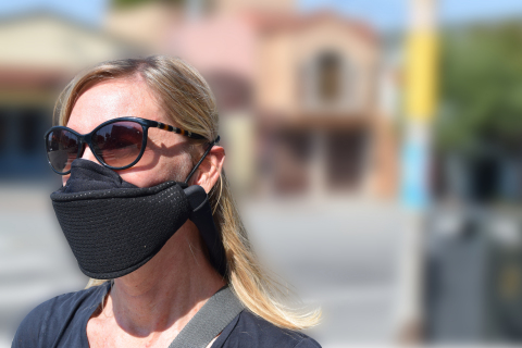 JustAir is a wearable, personal air-purifying respirator that delivers fresh HEPA-filtered air into a mask to create positive pressure around the nose and mouth for up to 12 hours; the cloth mask's electrostatic filter traps particulate from exhaled breath with 99.9% viral efficiency. (Photo: Business Wire)
