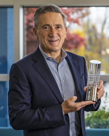 Entegris President and Chief Executive Officer, Bertrand Loy, with Supplier Excellence Award received from Lam Research (Photo: Business Wire)