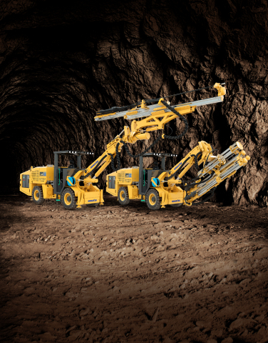 Komatsu's new jumbo drill (left) and bolter (right) utilize a common platform that allows operators to convert their machine from a jumbo to a bolter, and vice versa. (Photo: Business Wire)