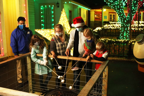 Enjoy s'mores and other seasonal treats during Holiday in the Park and the new Holiday in the Park Lights at select Six Flags parks. Come out and celebrate safely! (Photo: Business Wire)