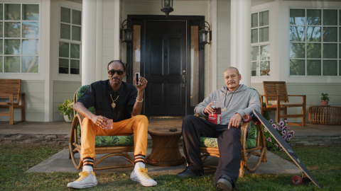 Vivint Guard Doggs—Snoop Dogg and Doggface chill on the front porch in new Vivint ad. (Photo: Business Wire)