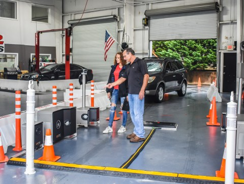 V.I.P Auctions founder Jim Smith explains UVeye's inspection system to a customer