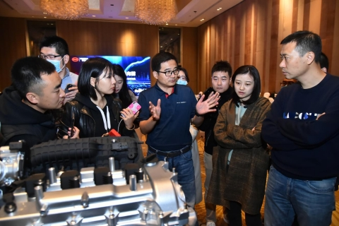 Eric Li, Deputy General Manager of BYD Auto Sales (Middle) presenting tech details of Xiaoyun Engine. (Photo: Business Wire)