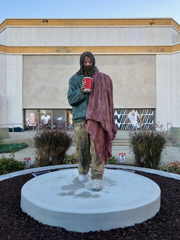 """On November 18, 2019, renowned Los Angeles artist and social justice advocate Ed Massey unveiled a seven-foot-tall sculpture of a homeless man he encountered years ago. The statue is entitled """"In the Image,"""" located on one of the highest-trafficked corners in Santa Monica, Calif. at Wilshire Boulevard and 26th St. (Olmstead Williams Communications)"""