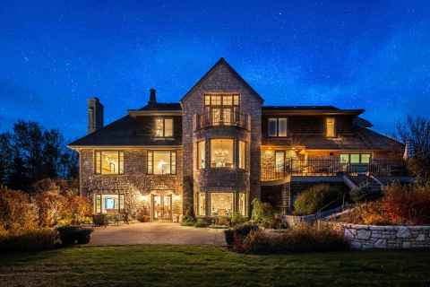 Headed to auction on November 30: Kingsdown Manor, a modern-European estate home in one of Canada's most exclusive communities near Calgary, Alberta. This private gem features stunning mountain views and close access to world-class outdoor activities. (Photo: Business Wire)