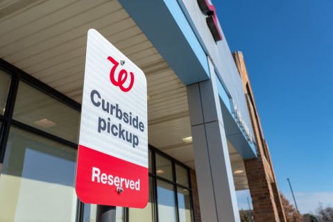 Walgreens pickup at curbside sign (Photo: Business Wire)
