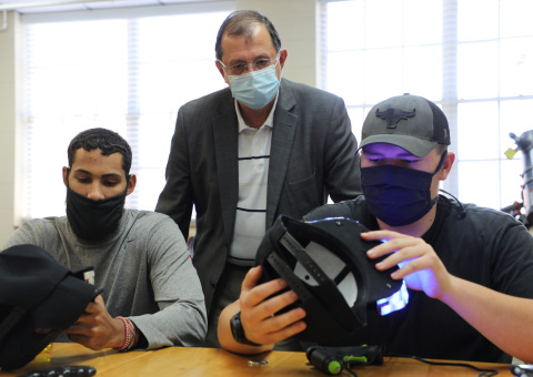 HPU's Talen Davis-Rentfro, Dr. Martin Mintchev and Jacob Bonner examine Aurakills prototypes. (Photo: Business Wire)