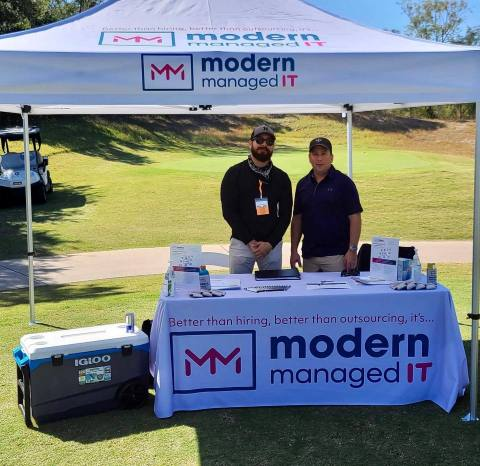 Alejandro Chavez (left), Business Development and Sean Wedige (right), CTO of Modern Managed IT at outdoor event in fall of 2020.  (Photo: Business Wire)