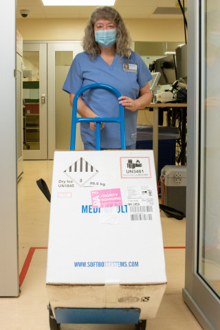 Michelle Vincent, Pharmacy Tech Lead, with the first doses of the COVID-19 vaccine delivered to Seattle Cancer Care Alliance. (Photo: Business Wire)