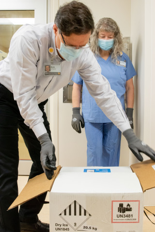 Rick LaFrance, Director of Pharmacy, Seattle Cancer Care Alliance, opens the first doses of the COVID-19 vaccine delivered to the cancer center. (Photo: Business Wire)