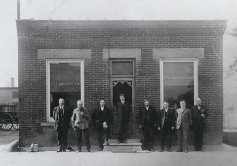 Claussen office with family (Photo: Business Wire)