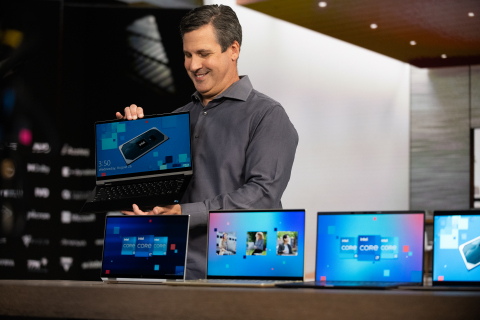 Chris Walker, Intel vice president, is filmed on the extended reality stage at Intrepid Studios in San Rafael, California, in August 2020 as part of Intel's introduction of 11th Gen Intel Core processors. The modernistic, airy wood-paneled room from which Walker presents was entirely virtual. The laptops, however, were quite real. (Credit: Intel Corporation)