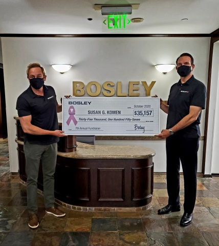 Rob Spurrell, CEO of Bosley (left) and Dr. Ken Washenik, President and Chief Medical Officer of Bosley (right) present a check for $35,157 to Susan G. Komen. (Photo: Business Wire)